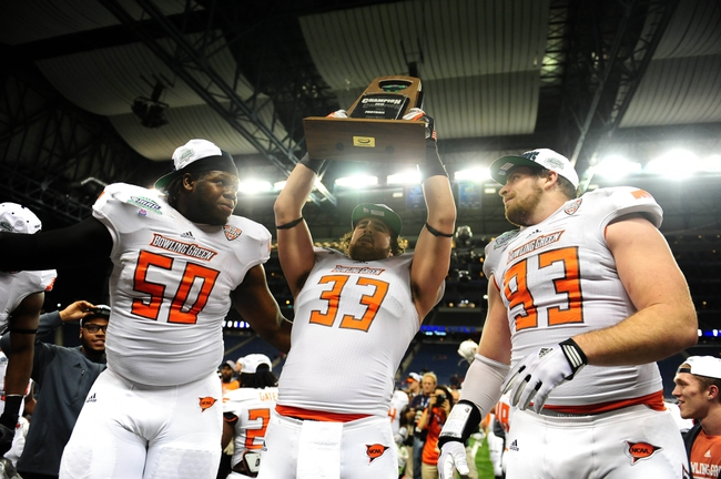 Dec 6, 2013; Detroit, MI, USA; Bowling Green Falcons defensive lineman Izaah Lunsford (50) linebacker Paul Swan (33) and defensive tackle Ted Ouellet (93) celebrate after defeating Northern Illinois Huskies 47-27 to win the MAC Championship at Ford Field. Mandatory Credit: Andrew Weber-USA TODAY Sports