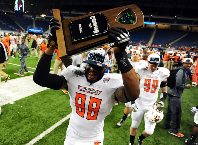 Dec 6, 2013; Detroit, MI, USA; Bowling Green Falcons kicker Tyler Tate (98) celebrates after defeating Northern Illinois Huskies 47-27 to win the MAC Championship at Ford Field. Mandatory Credit: Andrew Weber-USA TODAY Sports