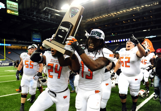 Dec 6, 2013; Detroit, MI, USA; Bowling Green Falcons defensive back BooBoo Gates (24) and running back Travis Greene (13) celebrates after defeating Northern Illinois Huskies 47-27 to win the MAC Championship at Ford Field. Mandatory Credit: Andrew Weber-USA TODAY Sports