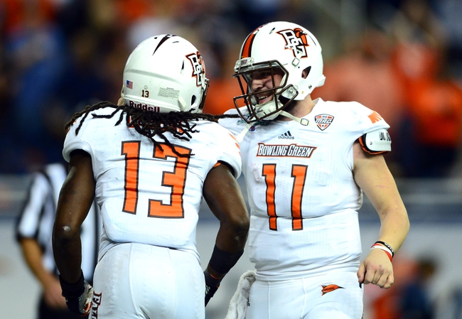 Dec 6, 2013; Detroit, MI, USA; Bowling Green Falcons running back Travis Greene (13) celebrates with quarterback Matt Johnson after a touchdown during the third quarter against the Northern Illinois Huskies at Ford Field. Mandatory Credit: Andrew Weber-USA TODAY Sports