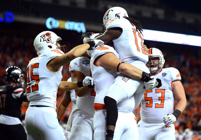 Dec 6, 2013; Detroit, MI, USA; Bowling Green Falcons running back Travis Greene (13) celebrates with teammates after scoring a touchdown during the fourth quarter against the Northern Illinois Huskies at Ford Field. Mandatory Credit: Andrew Weber-USA TODAY Sports