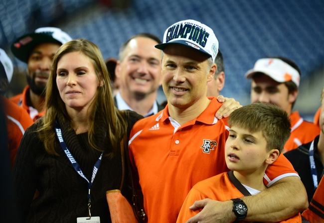 Dec 6, 2013; Detroit, MI, USA; Bowling Green Falcons head coach Dave Clawson celebrates with his family after defeating Northern Illinois Huskies 47-27 to win the MAC Championship at Ford Field. Mandatory Credit: Andrew Weber-USA TODAY Sports