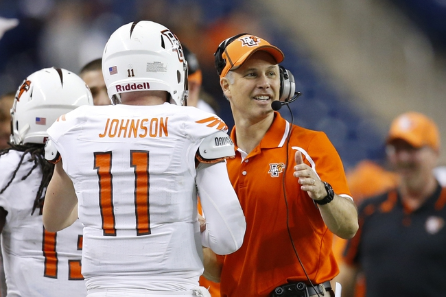 Dec 6, 2013; Detroit, MI, USA; Bowling Green Falcons head coach Dave Clawson congratulates quarterback Matt Johnson (11) after a touchdown in the fourth quarter against the Northern Illinois Huskies at Ford Field. Bowling Green won 47-27. Mandatory Credit: Rick Osentoski-USA TODAY Sports