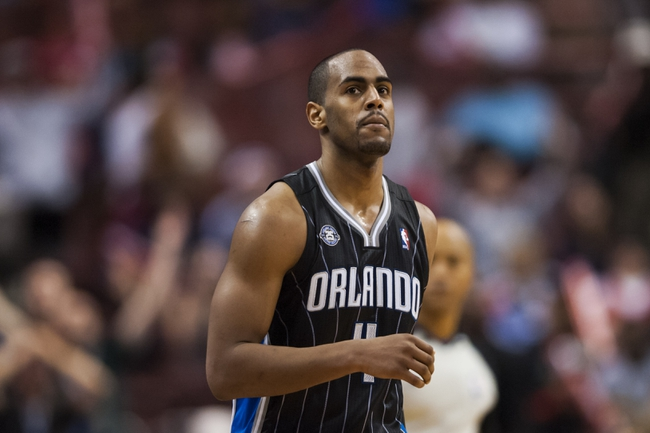 Dec 3, 2013; Philadelphia, PA, USA; Orlando Magic guard Arron Afflalo (4) during overtime against the Philadelphia 76ers at the Wells Fargo Center. The Sixers defeated the Magic 126-125 in double overtime. Mandatory Credit: Howard Smith-USA TODAY Sports