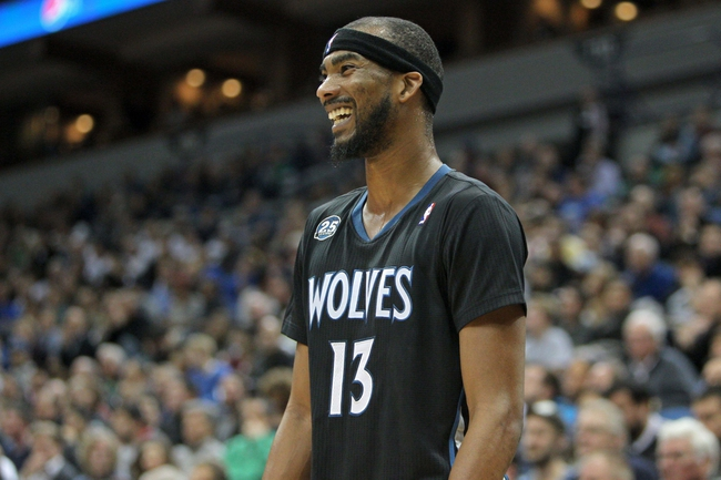 Nov 27, 2013; Minneapolis, MN, USA; Minnesota Timberwolves forward Corey Brewer (13) against the Denver Nuggets at Target Center. The Nuggets defeated the Timberwolves 117-110. Mandatory Credit: Brace Hemmelgarn-USA TODAY Sports
