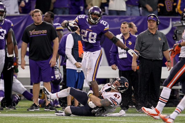 Dec 1, 2013; Minneapolis, MN, USA; Minnesota Vikings running back Adrian Peterson (28) against the Chicago Bears at Mall of America Field at H.H.H. Metrodome. The Vikings defeated the Bears 23-20 in overtime. Mandatory Credit: Brace Hemmelgarn-USA TODAY Sports