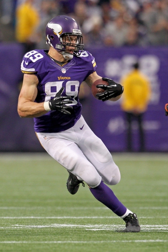 Dec 1, 2013; Minneapolis, MN, USA; Minnesota Vikings tight end John Carlson (89) against the Chicago Bears at Mall of America Field at H.H.H. Metrodome. The Vikings defeated the Bears 23-20 in overtime. Mandatory Credit: Brace Hemmelgarn-USA TODAY Sports