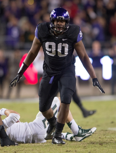 Nov 30, 2013; Fort Worth, TX, USA; TCU Horned Frogs defensive tackle Terrell Lathan (90) celebrates a sack of Baylor Bears quarterback Bryce Petty (14) during the game at Amon G. Carter Stadium. The Bears defeated the Horned Frogs 41-38. Mandatory Credit: Jerome Miron-USA TODAY Sports