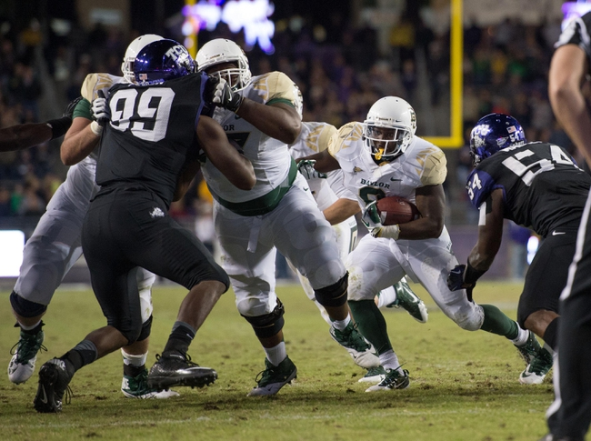Nov 30, 2013; Fort Worth, TX, USA; Baylor Bears running back Glasco Martin (8) runs through the TCU Horned Frogs defensive line during the game at Amon G. Carter Stadium. The Bears defeated the Horned Frogs 41-38. Mandatory Credit: Jerome Miron-USA TODAY Sports