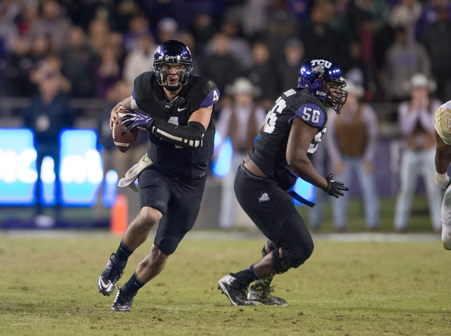 Nov 30, 2013; Fort Worth, TX, USA; TCU Horned Frogs quarterback Casey Pachall (4) runs for a first down against the Baylor Bears during the game at Amon G. Carter Stadium. The Bears defeated the Horned Frogs 41-38. Mandatory Credit: Jerome Miron-USA TODAY Sports