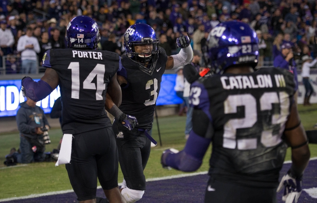 Nov 30, 2013; Fort Worth, TX, USA; TCU Horned Frogs wide receiver David Porter (14) and wide receiver Brandon Carter (3) and running back B.J. Catalon (23) celebrate a touchdown against the Baylor Bears during the game at Amon G. Carter Stadium. The Bears defeated the Horned Frogs 41-38. Mandatory Credit: Jerome Miron-USA TODAY Sports
