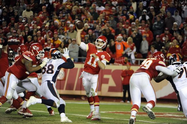 Dec 1, 2013; Kansas City, MO, USA; Kansas City Chiefs quarterback Alex Smith (11) throws a pass against the Denver Broncos in the second half at Arrowhead Stadium. Denver won the game 35-28. Mandatory Credit: John Rieger-USA TODAY Sports