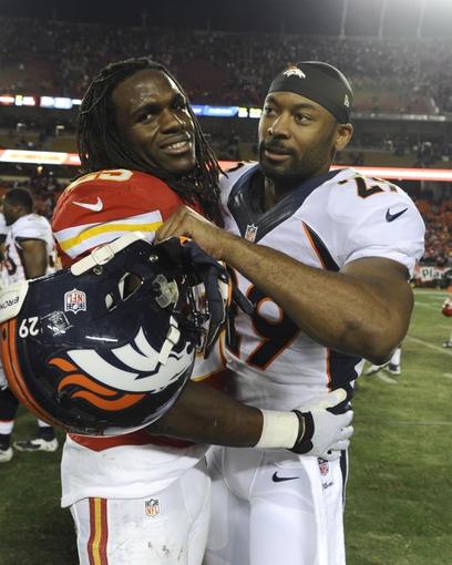 Dec 1, 2013; Kansas City, MO, USA; Kansas City Chiefs running back Jamaal Charles (25) talks to Denver Broncos free safety Michael Huff (29) after the game at Arrowhead Stadium. Denver won the game 35-28. Mandatory Credit: John Rieger-USA TODAY Sports