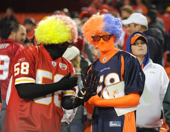 Dec 1, 2013; Kansas City, MO, USA; A Kansas City Chiefs fan and Denver Broncos fan show their support after the game at Arrowhead Stadium. Denver won 35-28. Mandatory Credit: Denny Medley-USA TODAY Sports