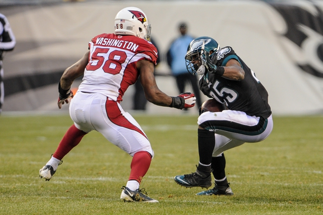 Dec 1, 2013; Philadelphia, PA, USA;  Philadelphia Eagles running back LeSean McCoy (25) tries to avoid Arizona Cardinals inside linebacker Daryl Washington (58) as he carries the ball in the fourth quarter of the game at Lincoln Financial Field. The Philadelphia Eagles won the game 24-21.  Mandatory Credit: John Geliebter-USA TODAY Sports