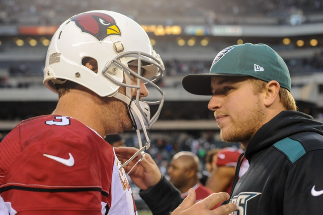Dec 1, 2013; Philadelphia, PA, USA;  Philadelphia Eagles quarterback Matt Barkley (2) talks with Arizona Cardinals quarterback Carson Palmer (3) after the game at Lincoln Financial Field. The Philadelphia Eagles won the game 24-21.  Mandatory Credit: John Geliebter-USA TODAY Sports