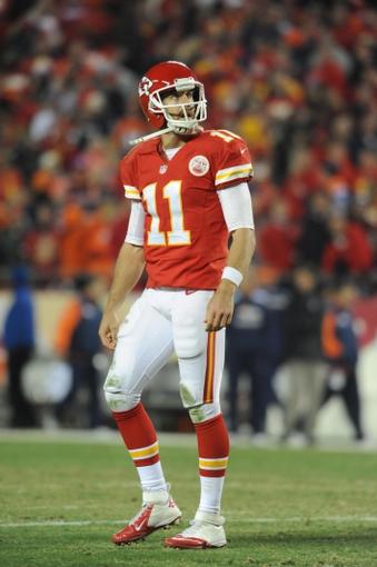 Dec 1, 2013; Kansas City, MO, USA; Kansas City Chiefs quarterback Alex Smith (11) watches the replay during the second half of the game against the Denver Broncos at Arrowhead Stadium. Denver won 35-28. Mandatory Credit: Denny Medley-USA TODAY Sports