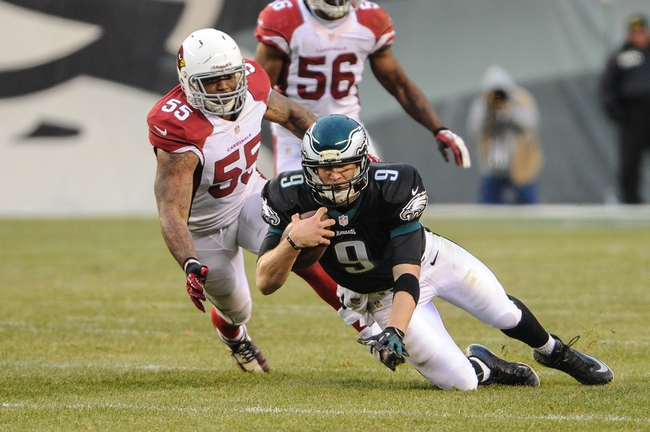 Dec 1, 2013; Philadelphia, PA, USA;  Philadelphia Eagles quarterback Nick Foles (9) is chased by Arizona Cardinals outside linebacker John Abraham (55) on a 6 yard run in the fourth quarter of the game at Lincoln Financial Field. The Philadelphia Eagles won the game 24-21.  Mandatory Credit: John Geliebter-USA TODAY Sports