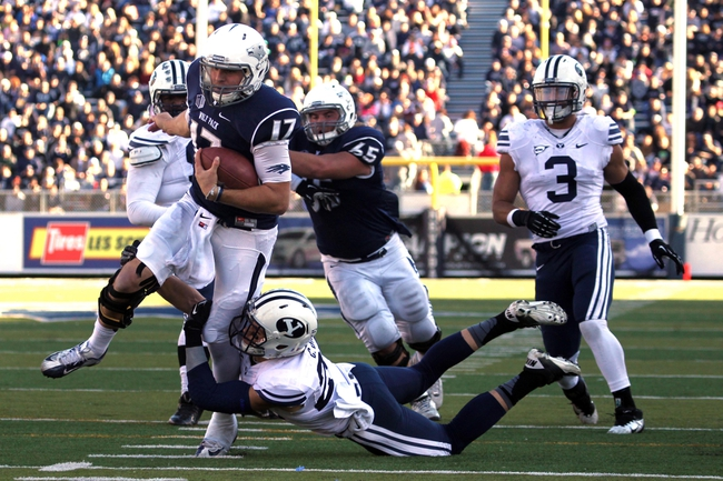 Nov 30, 2013; Reno, NV, USA; Nevada Wolf Pack quarterback Cody Fajardo (17) runs for a first down against the BYU Cougars in their NCAA football game at MacKay Stadium. Mandatory Credit: Lance Iversen/USA TODAY Sports. BYU won 28-23.