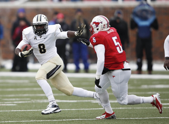 Dec 7, 2013; Dallas, TX, USA; UCF Knights running back Storm Johnson (8) runs the ball against Southern Methodist Mustangs linebacker Randall Joyner (5) during the first half of an NCAA football game at Gerald J. Ford Stadium. Mandatory Credit: Jim Cowsert-USA TODAY Sports