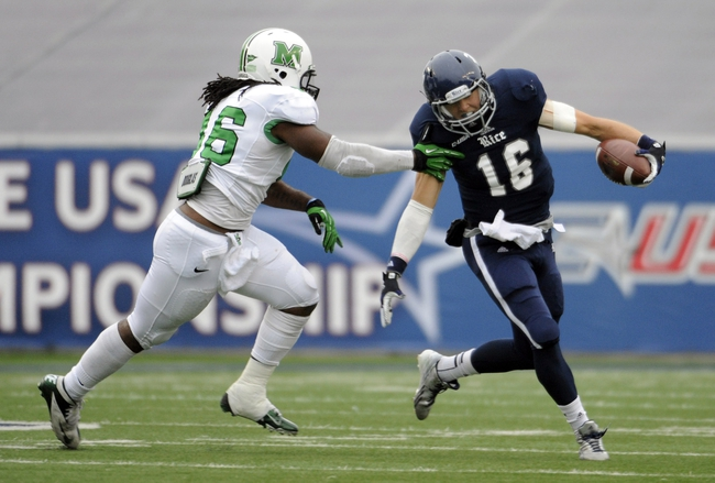 Dec 7, 2013; Houston, TX, USA; Rice Owls quarterback Taylor McHargue (16) is chased by Marshall Thundering Herd linebacker Jermaine Holmes (46) during the first half at Rice Stadium. Mandatory Credit: Brendan Maloney-USA TODAY Sports
