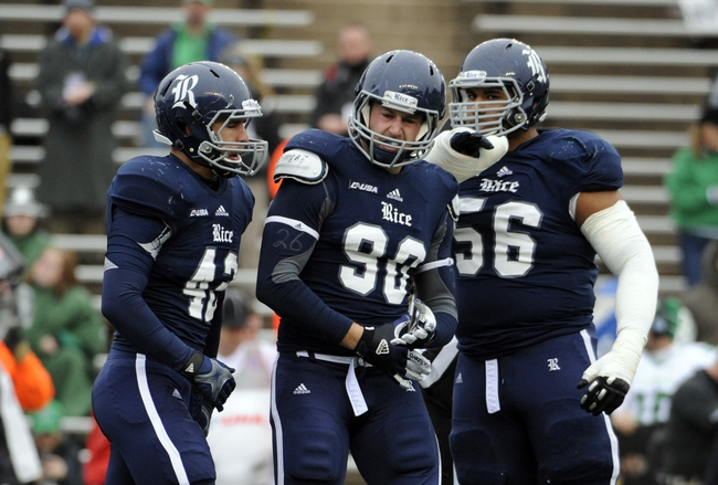 Dec 7, 2013; Houston, TX, USA; Rice Owls defensive end Cody Bauer (90 and linebacker Michael Kutzler (42) and defensive tackle Christian Covington (56) reacts after a sack against the Marshall Thundering Herd during the first half at Rice Stadium. Mandatory Credit: Brendan Maloney-USA TODAY Sports