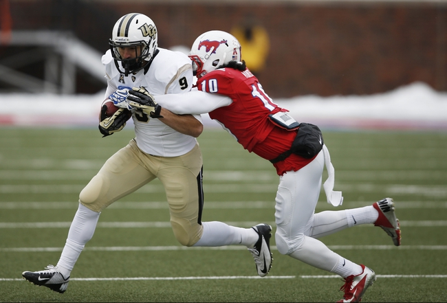 Dec 7, 2013; Dallas, TX, USA; UCF Knights wide receiver J.J. Worton (9) is tackled by Southern Methodist Mustangs defensive back Ajee Montes (10) after a catch during the first half of an NCAA football game at Gerald J. Ford Stadium. Mandatory Credit: Jim Cowsert-USA TODAY Sports