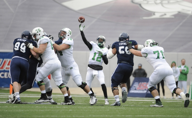 Dec 7, 2013; Houston, TX, USA; Marshall Thundering Herd quarterback Rakeem Cato (12) passes the ball against the Rice Owls during the first half at Rice Stadium. Mandatory Credit: Brendan Maloney-USA TODAY Sports