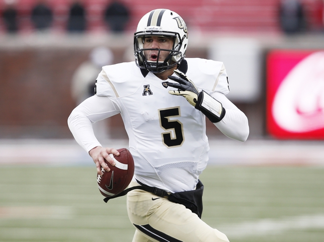 Dec 7, 2013; Dallas, TX, USA; UCF Knights quarterback Blake Bortles (5) runs for a touchdown against the Southern Methodist Mustangs during the second half of an NCAA football game at Gerald J. Ford Stadium. UCF Knights won 17-13. Mandatory Credit: Jim Cowsert-USA TODAY Sports