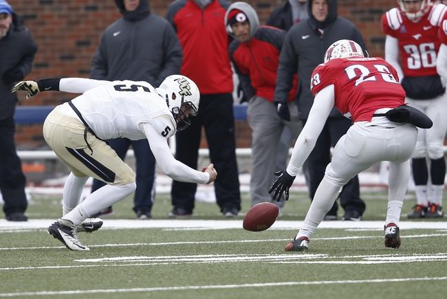 Dec 7, 2013; Dallas, TX, USA; UCF Knights quarterback Blake Bortles (5) and Southern Methodist Mustangs linebacker Stephon Sanders (23) battle for a fumbled ball during the second half of an NCAA football game at Gerald J. Ford Stadium. UCF Knights recovered the ball. UCF Knights won 17-13. Mandatory Credit: Jim Cowsert-USA TODAY Sports
