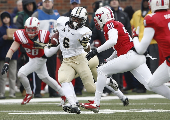 Dec 7, 2013; Dallas, TX, USA; UCF Knights wide receiver Rannell Hall (6) runs with the ball in front of Southern Methodist Mustangs defensive back A.J. Justice (20) during the second half of an NCAA football game at Gerald J. Ford Stadium. UCF Knights won 17-13. Mandatory Credit: Jim Cowsert-USA TODAY Sports