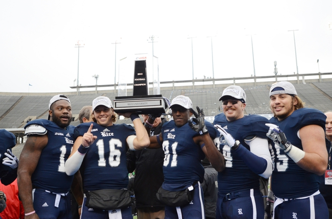 Dec 7, 2013; Houston, TX, USA; Rice Owls (from left) running back Charles Ross and quarterback Taylor McHague and wide receiver Donte Moore and safety Paul Porras and running back Luke Turner react after defeating the Marshall Thundering Herd during the second half of the Conference USA championship game at Rice Stadium. Rice beat Marshall 41-24. Mandatory Credit: Brendan Maloney-USA TODAY Sports