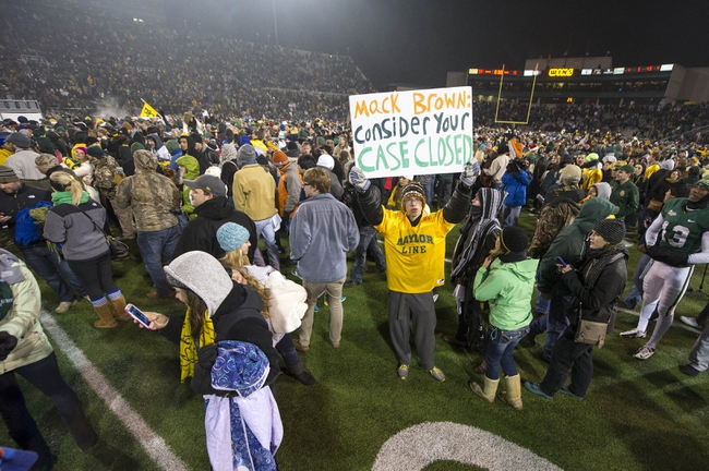 Dec 7, 2013; Waco, TX, USA; A Baylor Bears fan holds up a sign for Texas Longhorns in the last game ever at Floyd Casey Stadium. The Bears won 30-10.  Mandatory Credit: Jerome Miron-USA TODAY Sports