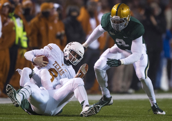 Dec 7, 2013; Waco, TX, USA; Texas Longhorns quarterback Case McCoy (6) is sacked by Baylor Bears defensive end Jamal Palmer (92) and defensive end Shawn Oakman (2) during the second half at Floyd Casey Stadium. The Bears won 30-10 to win the Big 12 championship. Mandatory Credit: Jerome Miron-USA TODAY Sports