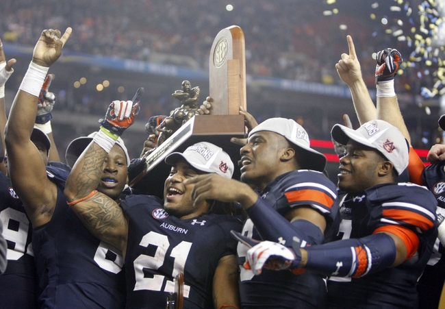Dec 7, 2013; Atlanta, GA, USA; Auburn Tigers running back Tre Mason (21) celebrates with teammates after defeating the Missouri Tigers in the 2013 SEC Championship game at Georgia Dome. Auburn won 59-42. Mandatory Credit: Brett Davis-USA TODAY Sports