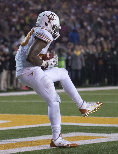 Dec 7, 2013; Waco, TX, USA; Baylor Bears running back Devin Chafin (28) catches a touchdown pass against the Baylor Bears during the second half at Floyd Casey Stadium. The Bears won 30-10 to win the Big 12 championship. Mandatory Credit: Jerome Miron-USA TODAY Sports