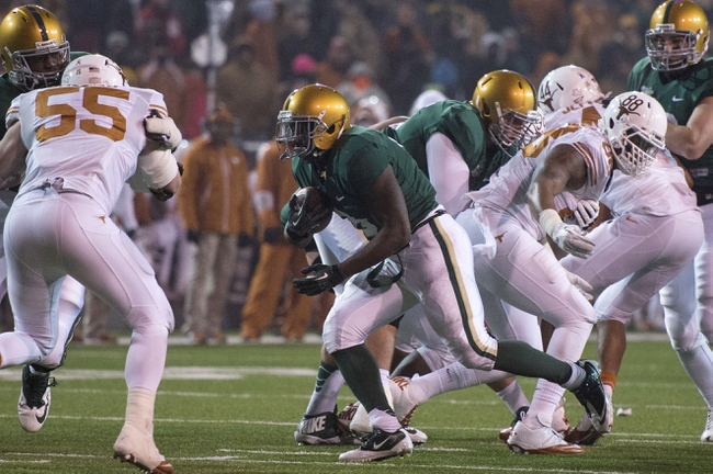Dec 7, 2013; Waco, TX, USA; Baylor Bears running back Glasco Martin (8) runs with the ball to score a touchdown against the Texas Longhorns during the second half at Floyd Casey Stadium. The Bears won 30-10 to win the Big 12 championship. Mandatory Credit: Jerome Miron-USA TODAY Sports