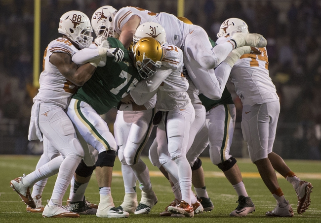 Dec 7, 2013; Waco, TX, USA; Texas Longhorns defensive end Cedric Reed (88) and linebacker Dalton Santos (55) and cornerback Leroy Scott (31) tackle Baylor Bears running back Glasco Martin (8) during the second half at Floyd Casey Stadium. The Bears won 30-10 to win the Big 12 championship. Mandatory Credit: Jerome Miron-USA TODAY Sports