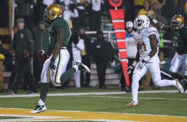 Dec 7, 2013; Waco, TX, USA; Baylor Bears running back Glasco Martin (8) scores a touchdown against the Texas Longhorns during the second half at Floyd Casey Stadium. The Bears won 30-10 to win the Big 12 championship. Mandatory Credit: Jerome Miron-USA TODAY Sports