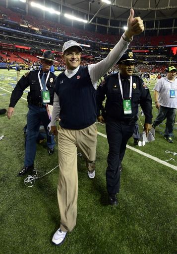 Dec 7, 2013; Atlanta, GA, USA; Auburn Tigers head coach Gus Malzahn gives a thumbs up as he walks off the field after defeating the Missouri Tigers in the 2013 SEC Championship game at Georgia Dome. Auburn won 59-42. Mandatory Credit: John David Mercer-USA TODAY Sports