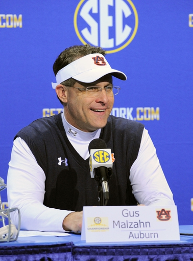 Dec 7, 2013; Atlanta, GA, USA; Auburn Tigers head coach Gus Malzahn  addresses the media following his win over the Missouri Tigers in the 2013 SEC Championship game at Georgia Dome. Auburn defeated Missouri 59-42. Mandatory Credit: Dale Zanine-USA TODAY Sports