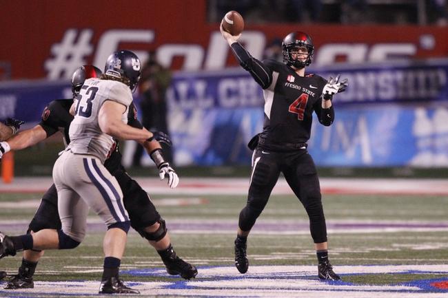 Dec 7, 2013; Fresno, CA, USA; Fresno State Bulldogs quarterback Derek Carr (4) throws a pass against the Utah State Aggies in the second quarter at Bulldog Stadium. Mandatory Credit: Cary Edmondson-USA TODAY Sports