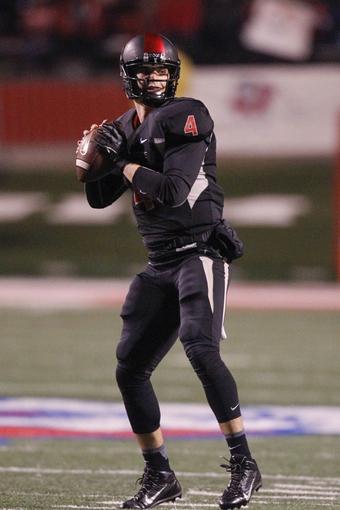 Dec 7, 2013; Fresno, CA, USA; Fresno State Bulldogs quarterback Derek Carr (4) prepares to throw a pass against the Utah State Aggies in the second quarter at Bulldog Stadium. Mandatory Credit: Cary Edmondson-USA TODAY Sports