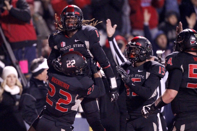 Dec 7, 2013; Fresno, CA, USA; Fresno State Bulldogs wide receiver Isaiah Burse (1) reacts after catching a touchdown pass against the Utah State Aggies in the second quarter at Bulldog Stadium. Mandatory Credit: Cary Edmondson-USA TODAY Sports
