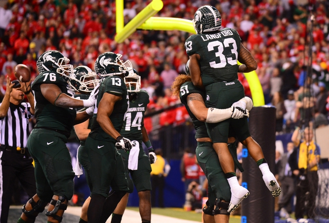 Dec 7, 2013; Indianapolis, IN, USA; Michigan State Spartans running back Jeremy Langford (33) celebrates with teammates after scoring a touchdown during the fourth quarter of the 2013 Big 10 Championship game against the Ohio State Buckeyes at Lucas Oil Stadium. Mandatory Credit: Andrew Weber-USA TODAY Sports
