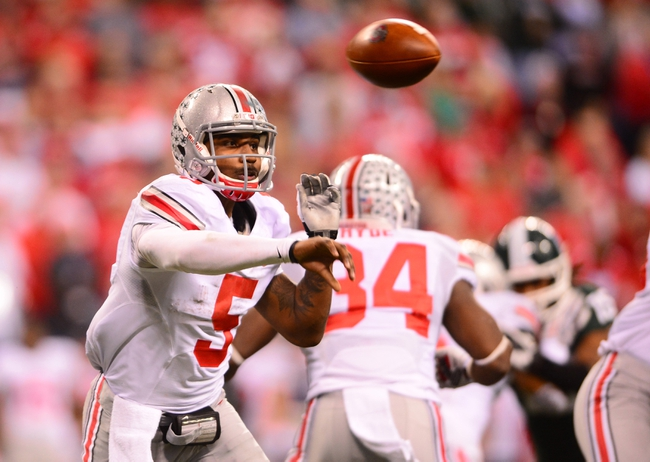 Dec 7, 2013; Indianapolis, IN, USA; Ohio State Buckeyes quarterback Braxton Miller (5) throws a pass during the third quarter of the 2013 Big 10 Championship game against the Michigan State Spartans at Lucas Oil Stadium. Mandatory Credit: Andrew Weber-USA TODAY Sports