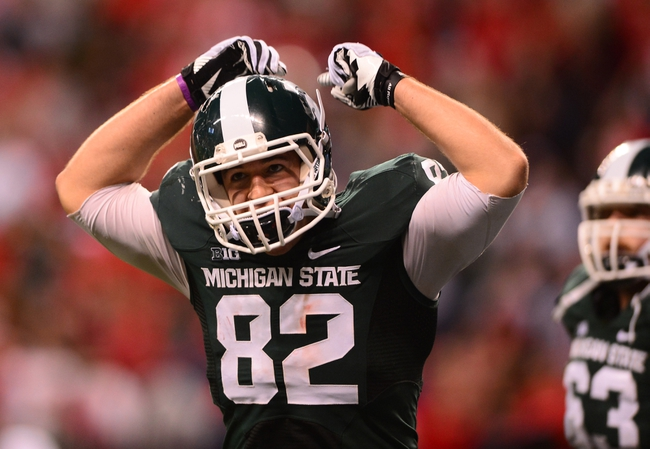 Dec 7, 2013; Indianapolis, IN, USA; Michigan State Spartans tight end Josiah Price (82) celebrates after catching a pass for a touchdown during the third quarter of the 2013 Big 10 Championship game against the Ohio State Buckeyes  at Lucas Oil Stadium. Mandatory Credit: Andrew Weber-USA TODAY Sports
