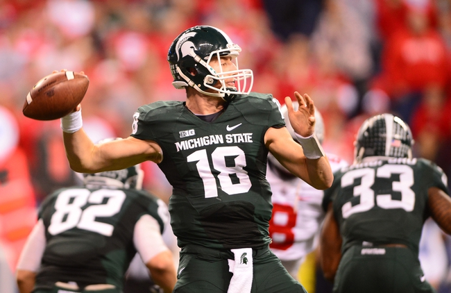 Dec 7, 2013; Indianapolis, IN, USA; Michigan State Spartans quarterback Connor Cook (18) throws a pass during the fourth quarter of the 2013 Big 10 Championship game against the Ohio State Buckeyes at Lucas Oil Stadium. Mandatory Credit: Andrew Weber-USA TODAY Sports