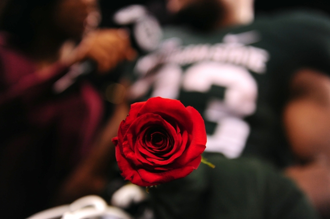 Dec 7, 2013; Indianapolis, IN, USA; Detailed view of a rose held by Michigan State Spartans running back Jeremy Langford (33) after defeating the Ohio State Buckeyes 32-24 to win the 2013 Big 10 Championship game at Lucas Oil Stadium. Mandatory Credit: Andrew Weber-USA TODAY Sports