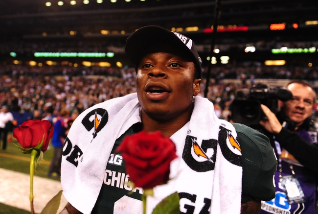 Dec 7, 2013; Indianapolis, IN, USA; Michigan State Spartans wide receiver Macgarrett Kings Jr. (3) with roses after defeating Ohio State Buckeyes 34-24 to win the 2013 Big 10 Championship game  at Lucas Oil Stadium. Mandatory Credit: Andrew Weber-USA TODAY Sports